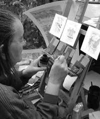 Photo - Norfolk Landscape Artist, Jan Dingle prepares her work